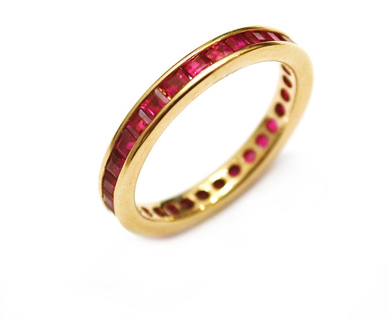Contemporary 18 Karat Yellow Gold Square Princess Cut Ruby Eternity Band For Sale