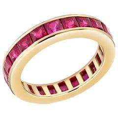 18 Karat Yellow Gold Square Princess Ruby Eternity Band Weighing 4.60 Carat