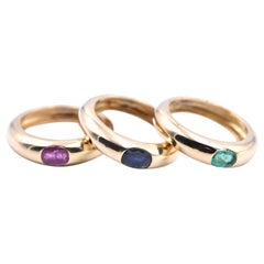 18 Karat Yellow Gold Stackable Emerald, Ruby, and Sapphire Band Set