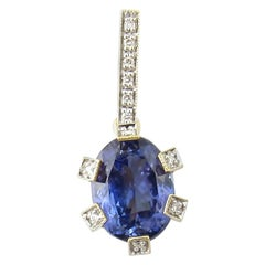 18 Karat Yellow Gold Tanzanite and Diamond Pendant