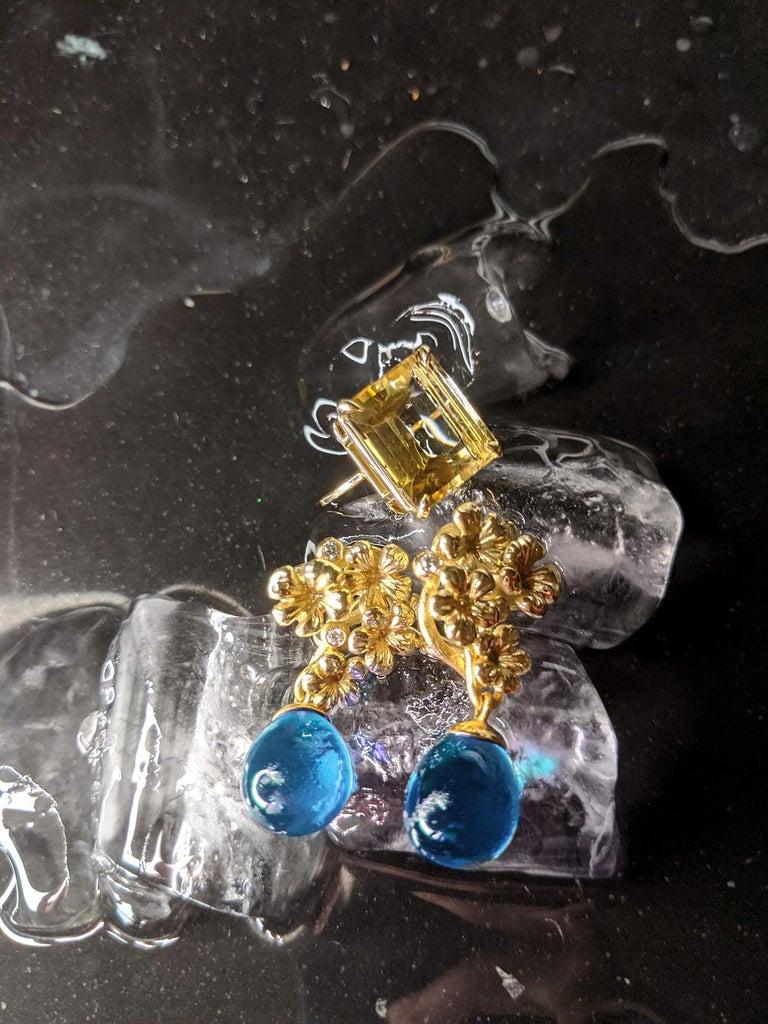 Round Cut 18 Karat Yellow Gold Transformer Drop Modern Brooch with Diamonds and Blue Topaz For Sale