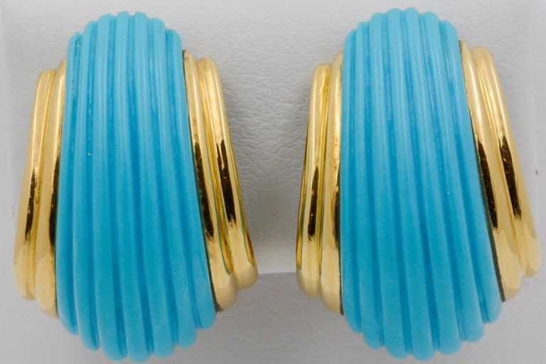 These contemporary turquoise earrings have a ribbed dome design with a splash of 18k yellow gold. These earrings have a clip-on backing.