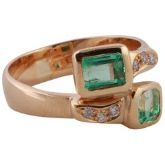 "18 Karat Yellow Gold ""Vous et Moi"" Ring with two Emeralds and Diamonds"