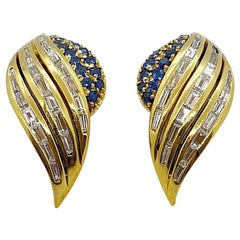 18 Karat Yellow Gold Winged Earrings with Baguette Diamonds and Blue Sapphires