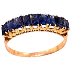 18 Karat Yellow Gold with Nine Sapphire Baguettes Band / Ring