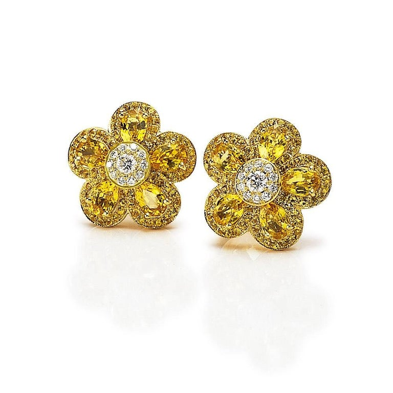 Cellini's  iconic Flower Power earrings . These stunning earrings are composed with five pear shaped  yellow sapphires  ,with a round brilliant diamond center. Each petal and center are surrounded with micro pave. The Flower measures approximately