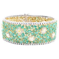 18 Karat Yellow & White Gold Emerald, Natural Color Diamond, & Diamond Bracelet