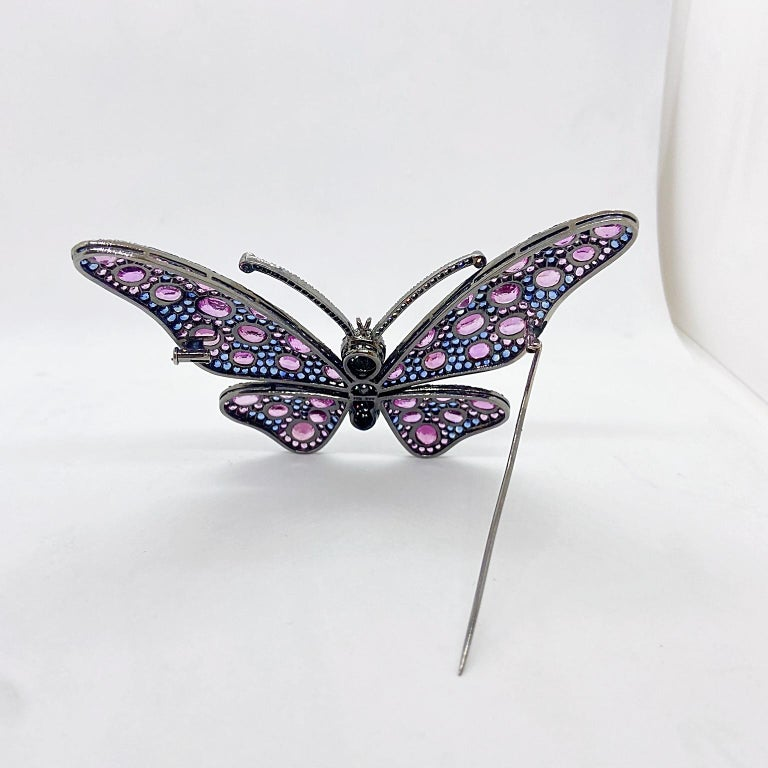 Contemporary 18 Karat Blackened Gold Butterfly Brooch with Diamonds, Pink and Blue Sapphires For Sale