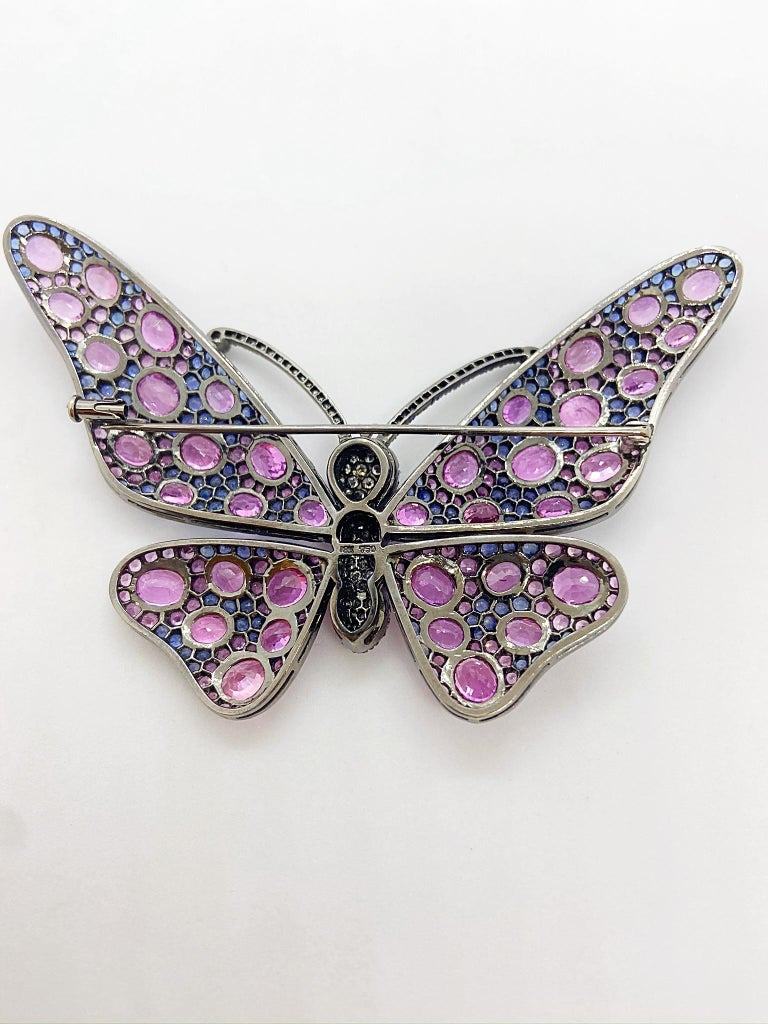 Oval Cut 18 Karat Blackened Gold Butterfly Brooch with Diamonds, Pink and Blue Sapphires For Sale