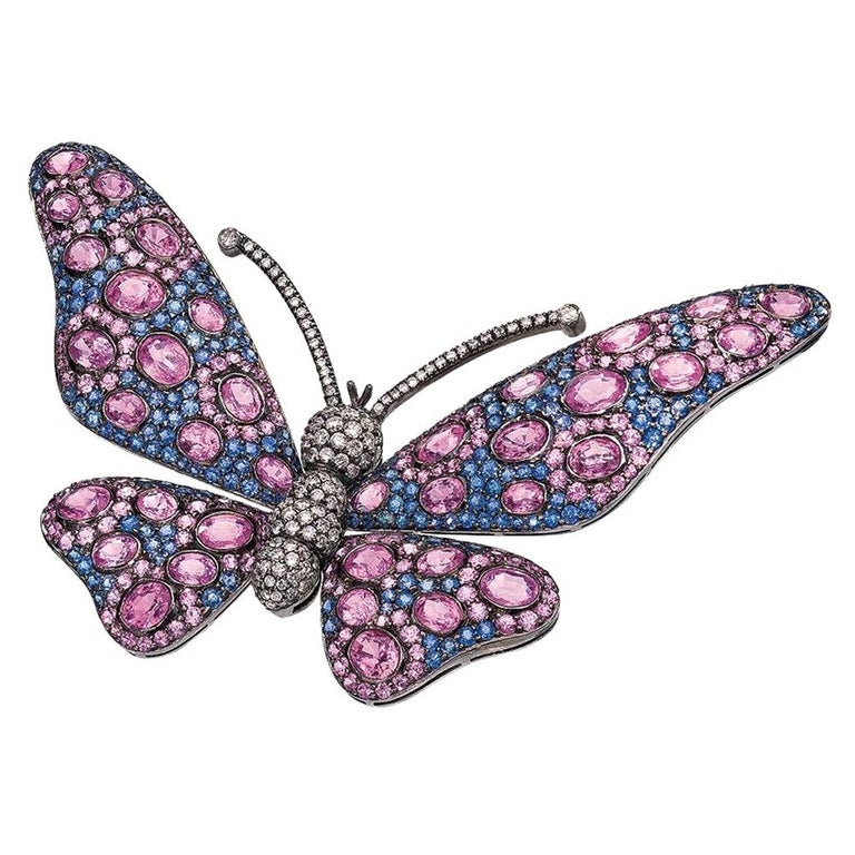 18 Karat Blackened Gold Butterfly Brooch with Diamonds, Pink and Blue Sapphires For Sale