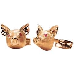 18 Karat Rose Gold Pig Head Cufflinks with Ruby Eyes