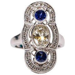 18 kt White Gold 0.52 Ct Blue Sapphire 1.30 Ct Oval White Diamond Long Ring