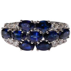 18 Kt White Gold Oval Cut 2.7 Ct Blue Sapphire 0.44 Ct Diamond Floral Band Ring