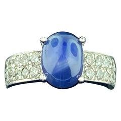 18 Karat White Gold Diamond and Blue Star Sapphire Ring