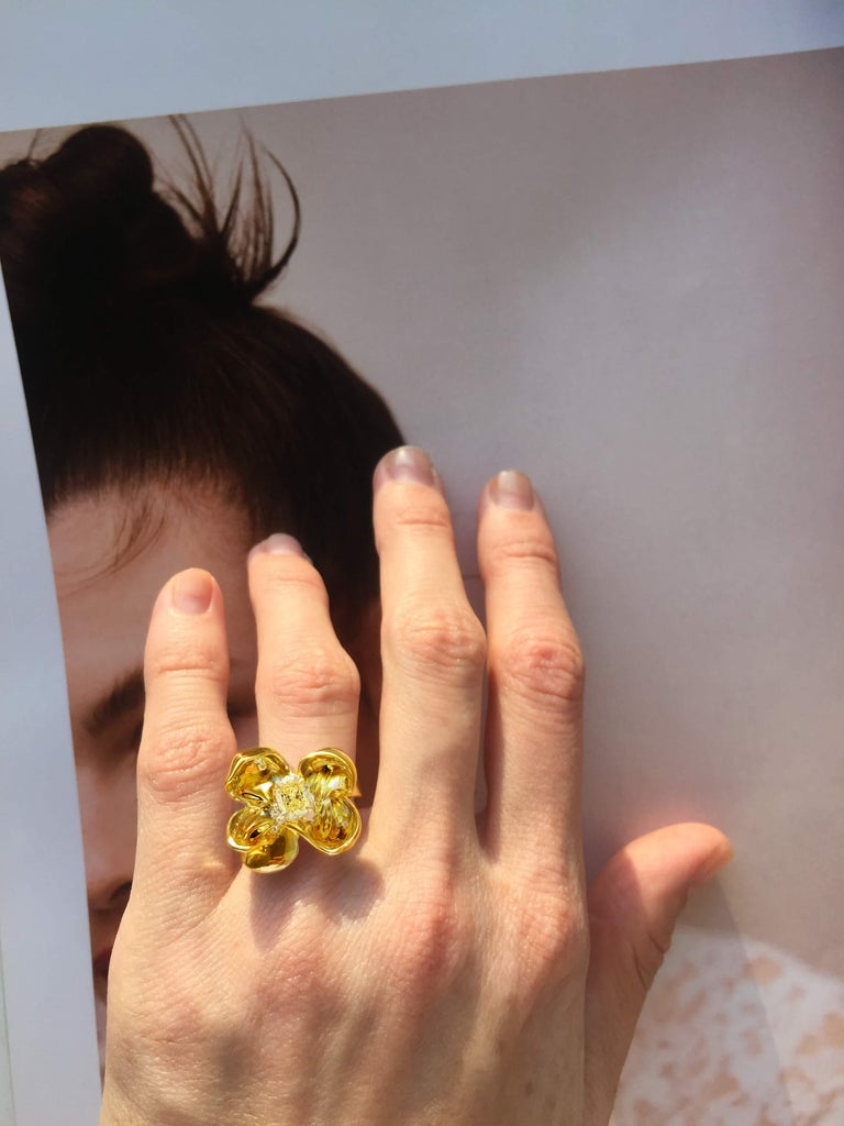 This Magnolia Flower engagement or cocktail ring is in 18 karat yellow gold with big GIA certified yellow diamond of great characteristics. Crushed ice cushion shape fits the best for the yellow diamonds. The lightenings between the petals of the 18