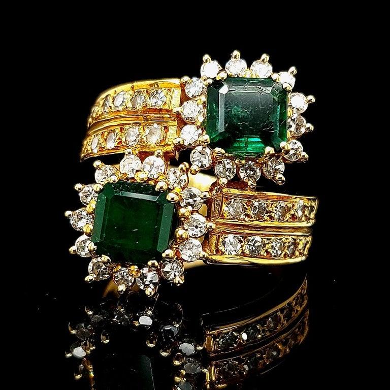 18 kt Yellow Gold Toi Et Moi Colombian Emeralds, Diamond Ring  Beautiful deep dark green Colombian Emeralds to make you shine every day.  Emerald: 2 Colombian emeralds Emerald cut ca. 3 ct together   Diamonds: 20 eight cut diamonds Ca. 0,6