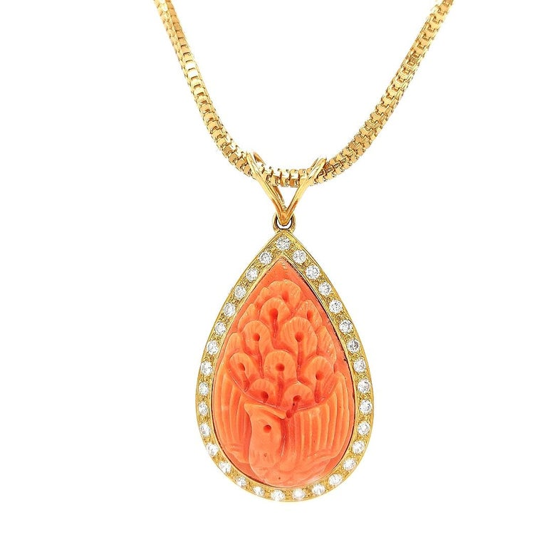 18 Karat Golden Necklace with Carved Coral Pendant and 0.70 Carat Diamonds For Sale 1