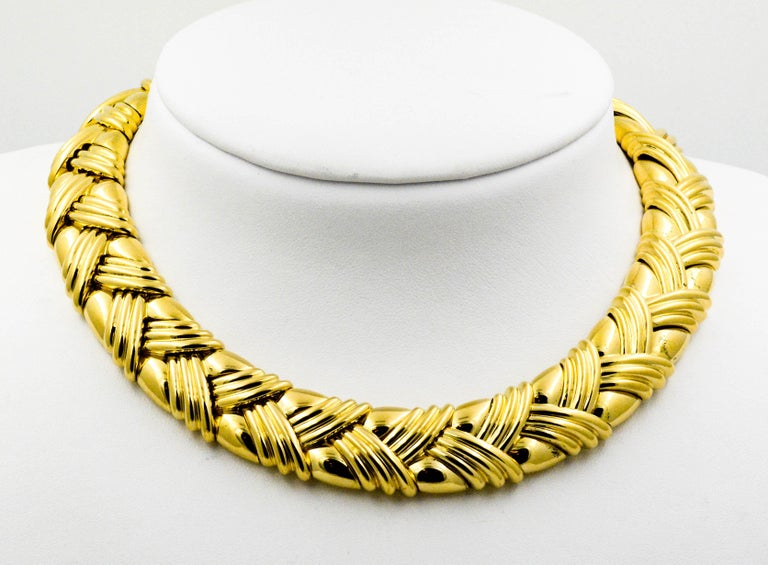 Circa 1980's 18 Karat Yellow Gold 16 inch Basket Weave Collar Necklace in excellent condition. 18 mm wide with an integrated clasp.