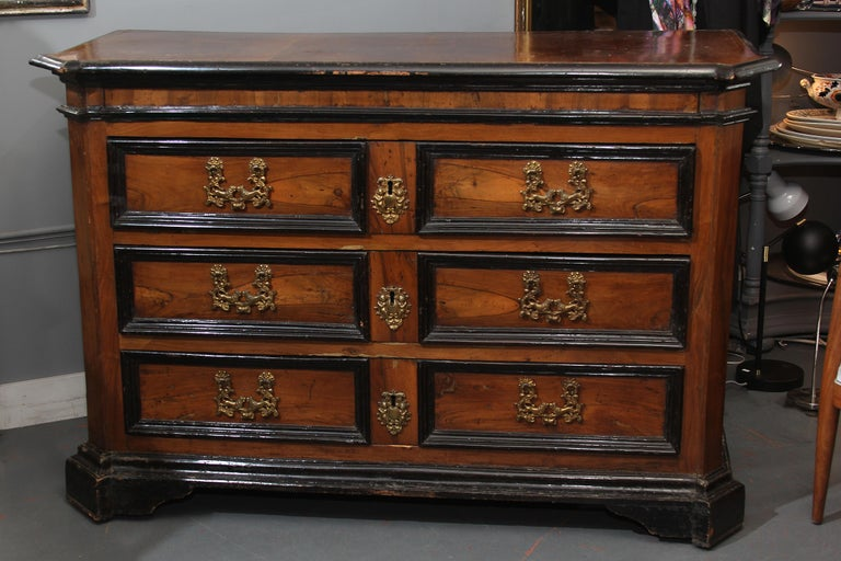 Grand chest with 3 drawers , lined in green silk. Drawer pulls with facing lions and key for drawer locks. Would be great in any room - the size and character of this piece would work in an entry or as a side board as well as a chest in a bedroom.