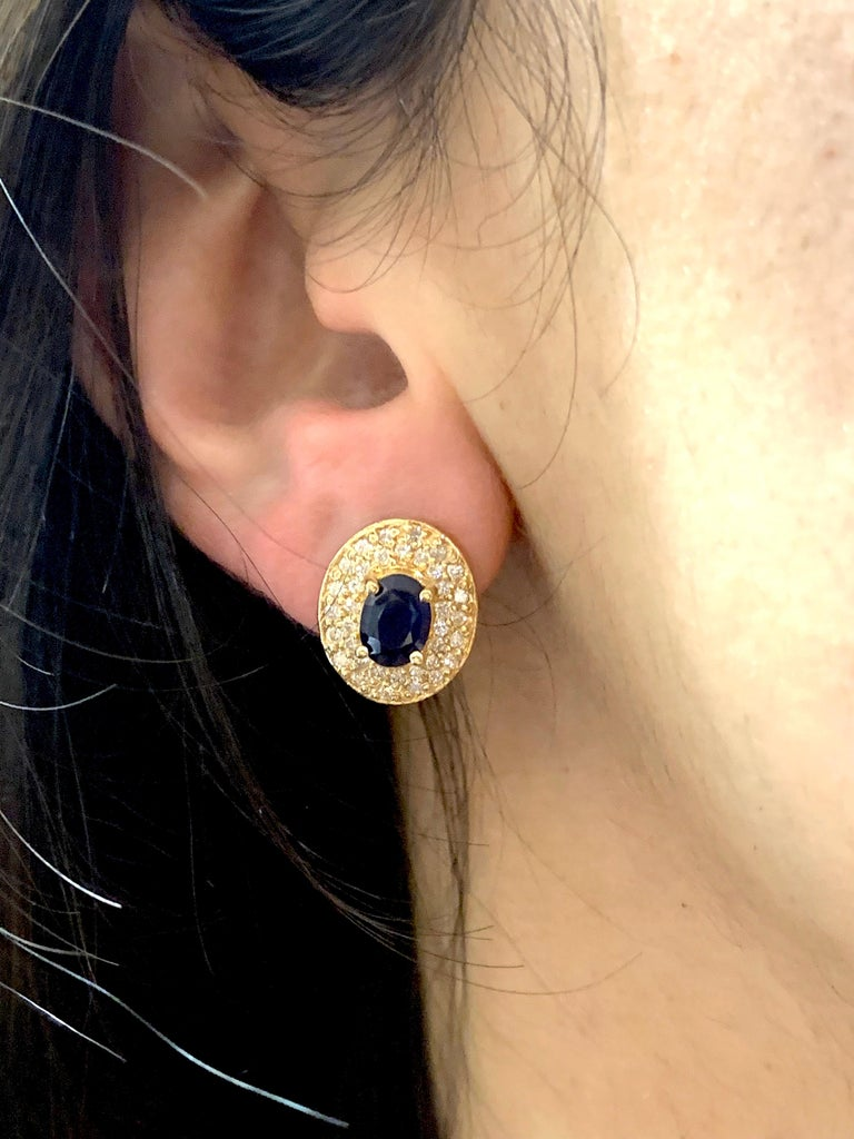 Contemporary 1.80 Carat Oval Sapphire and .72 Carat Diamond Earrings For Sale