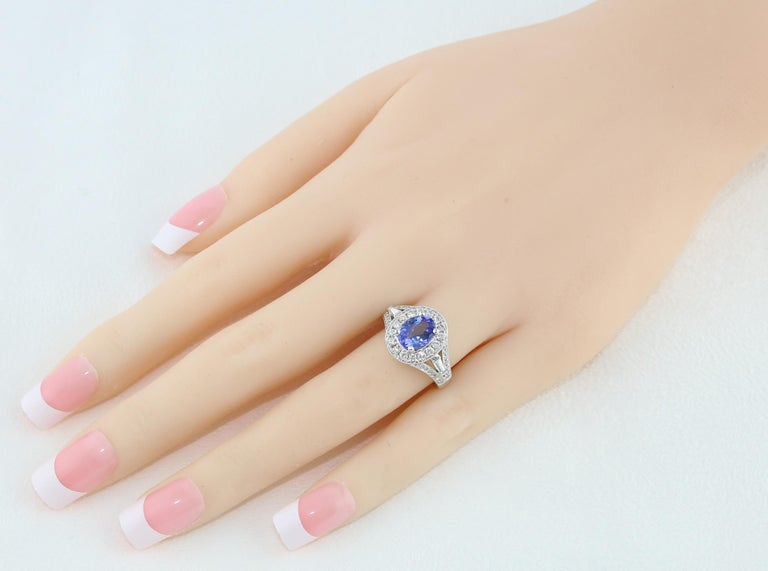 Contemporary 1.80 Carat Oval Tanzanite Diamond Halo Gold Ring For Sale