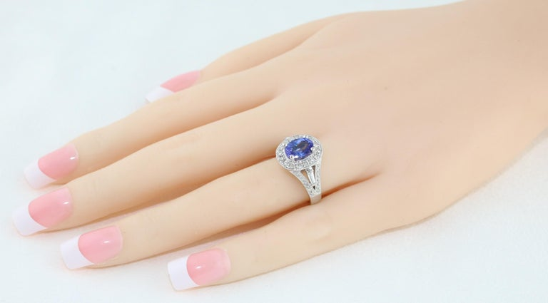 Oval Cut 1.80 Carat Oval Tanzanite Diamond Halo Gold Ring For Sale