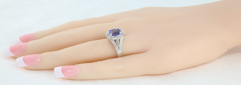 Women's 1.80 Carat Oval Tanzanite Diamond Halo Gold Ring For Sale