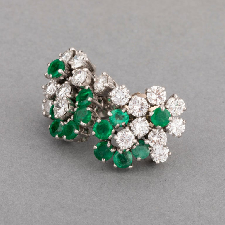 1.80 Carats Diamonds and 1.20 Carats Emeralds Earrings   Very beautiful pair of earrings. Made in France circa 1970. Set in white gold 18k. Dimensions: 1.6*1.5 cm Stud system. Total weight 8.50 grams.