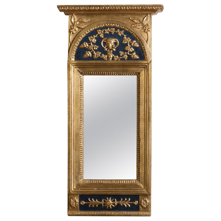 Gilded or panted Empire mirror, first half of the 1800s. The mirror is in a later period restored and partly newly painted. Overall condition is good.