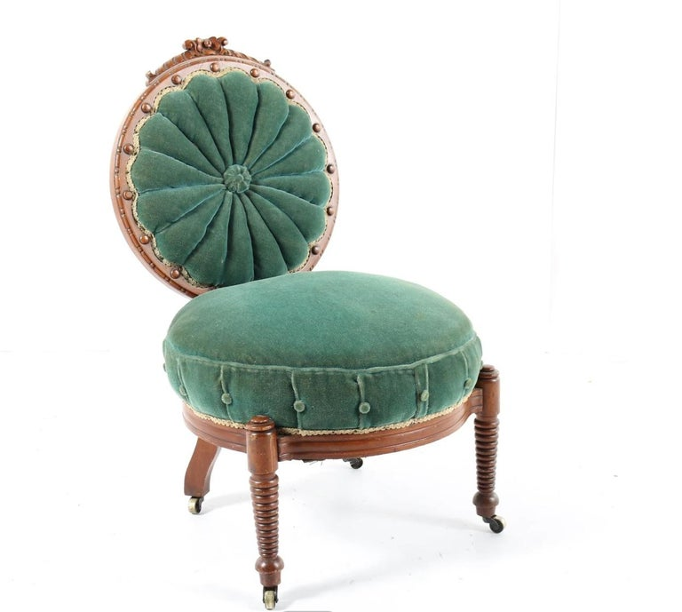 An incredibly Detailed Victorian, circa 1870-1890, light mahogany or cherrywood carved most charming green velvet chair with many old world refined details- An antique Victorian luscious emerald green velvet upholstered accent chair. This chair
