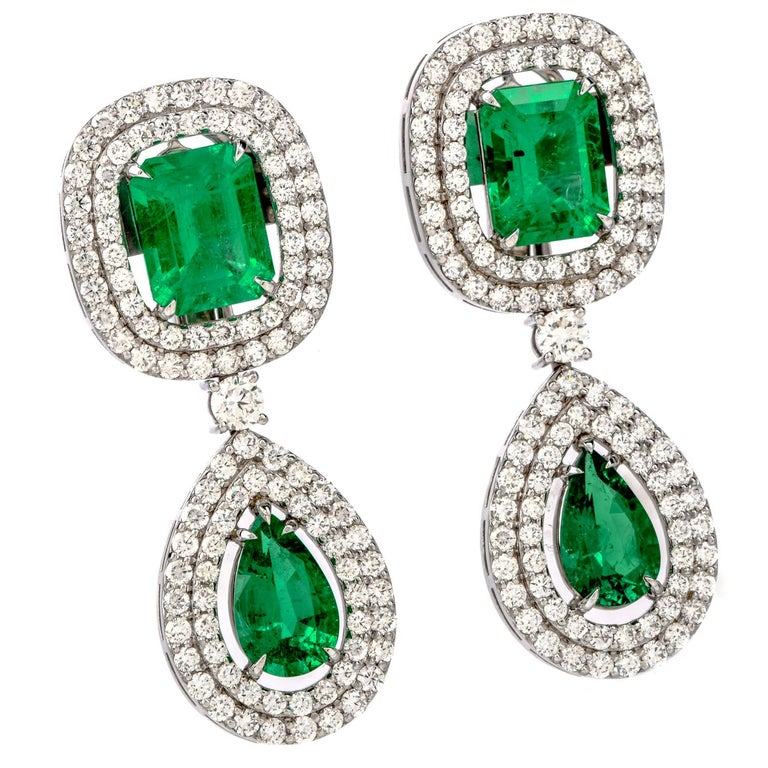 Shine Brightly with these shockingly stunning Diamond Colombian Emerald 18K Gold Halo 18.08 carat Drop Earrings!  These dazzling dangle drop earrings are crafted in 18 karat white gold.   There are four genuine very fine Colombian emeralds of