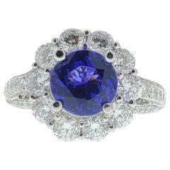 1.81 Carat Tanzanite and Diamond Halo Ring in 18 Karat White Gold