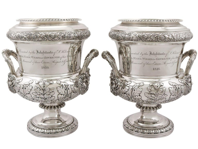 A magnificent, fine and impressive pair of antique Georgian English sterling silver wine coolers, an addition to our antique wine and drink related silverware collection.  These magnificent antique George III sterling silver wine coolers have a