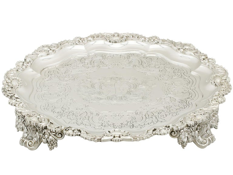 A magnificent, fine and impressive antique George III English sterling silver salver made by Paul Storr; an addition to our range of collectable silverware.  This magnificent antique George III sterling silver salver has a circular shaped