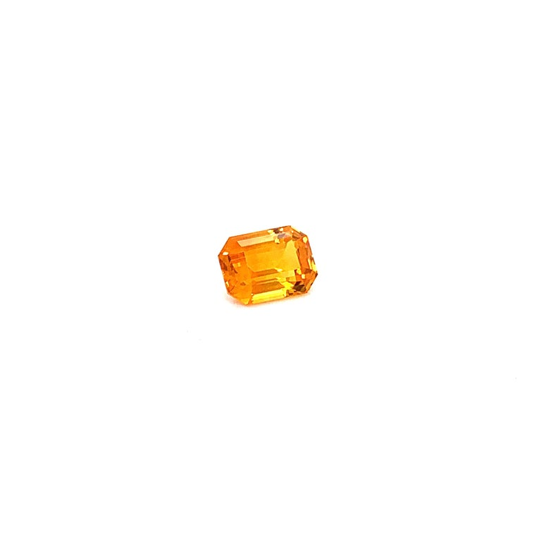1.82 Carat Emerald-Cut Natural Orange Sapphire:  A beautiful stone, it is an emerald-cut orange sapphire weighing a total of 1.82 carat. The sapphire has excellent cutting proportions, and possess extremely fine colour saturation and brilliance. The