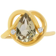 1.83 Carat Pear Shaped Natural Color Changing Anatolite and White Diamond Ring