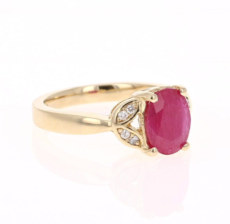 Simply beautiful Ruby Diamond Ring with a Oval Cut 1.75 Carat Ruby which is surrounded by 8 Round Cut Diamonds that weigh 0.08 carats. The total carat weight of the ring is 1.83 carats.   The ring is curated in 14K Yellow Gold and weighs
