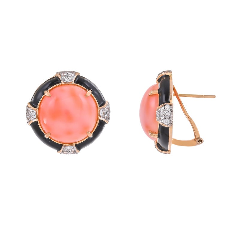 Modern and stylish this 18 karat earring features a bold, geometric shape set with the eccentric combination of 18.37 carats coral surrounded by sparkling white 0.81 carats diamonds and solid black enamel, highlights this statement yellow gold