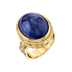 18.38 Carat Oval Cabochon Tanzanite Diamond Yellow Gold Engraved Bezel Dome Ring