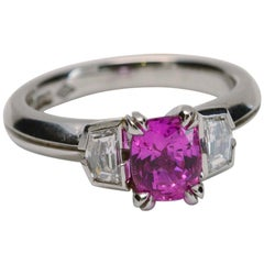 1.85 Carat Natural Pink Sapphire with 0.45 Carat Diamonds Three-Stone Ring