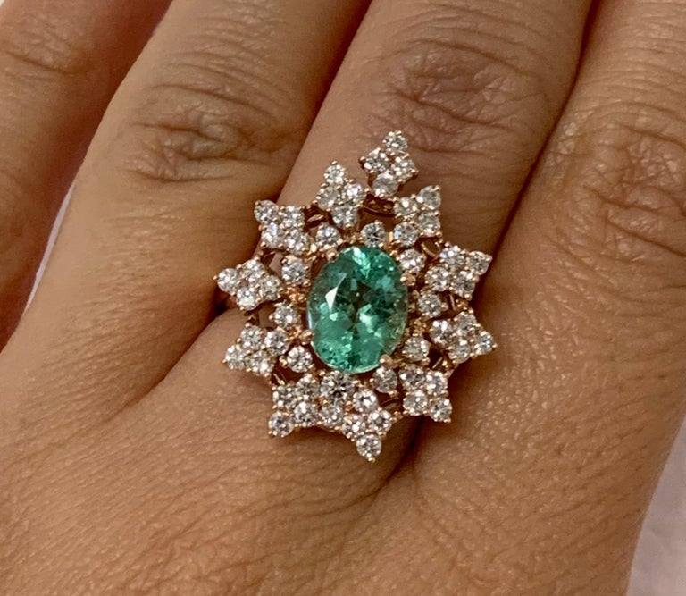 Material: 14k Rose Gold   Center Stone Details: 1.85 Carat Oval Shaped Paraiba Tourmaline -Measuring 8.8 x 6.9 mm Diamond Details: 55 Brilliant Round White Diamonds at Approximately 1.2 Carats - Clarity: SI / Color: H-I Ring Size: 6.75.