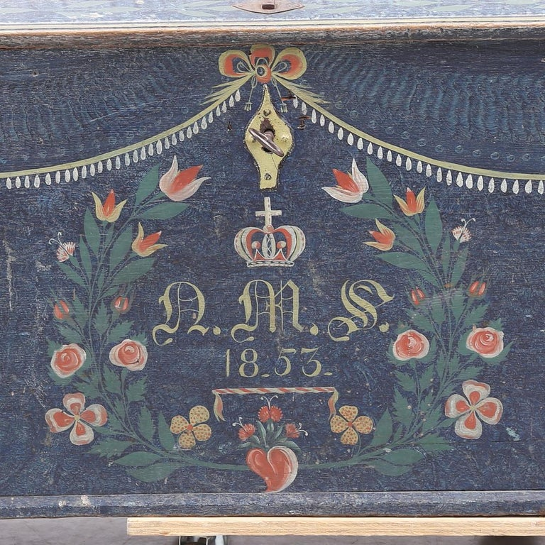 Extremely rare antique Swedish country Gustavian blanket box chest in the original hand painted polychromatic finish in the Jamtland style dated 1851.  Beautiful light blues, darker blues, reds and ochres with hand painted flower wreaths and the