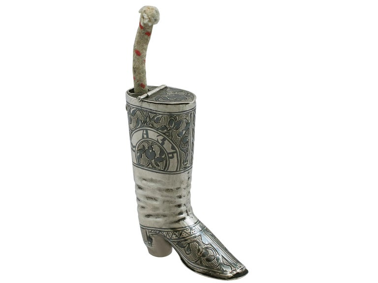 An exceptional, fine and impressive antique Russian silver vesta case in the form of a boot; an addition to our diverse smoking related silverware collection.  This exceptional antique silver vesta case has been realistically modelled in the form