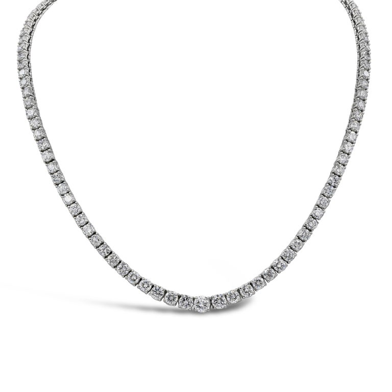 A simple yet very brilliant piece showcasing round diamonds that elegantly graduate larger as it reaches the center of the necklace. Diamonds weigh 18.75 carats total and are very fine quality (approximately G color, VS+ quality). Made in platinum.