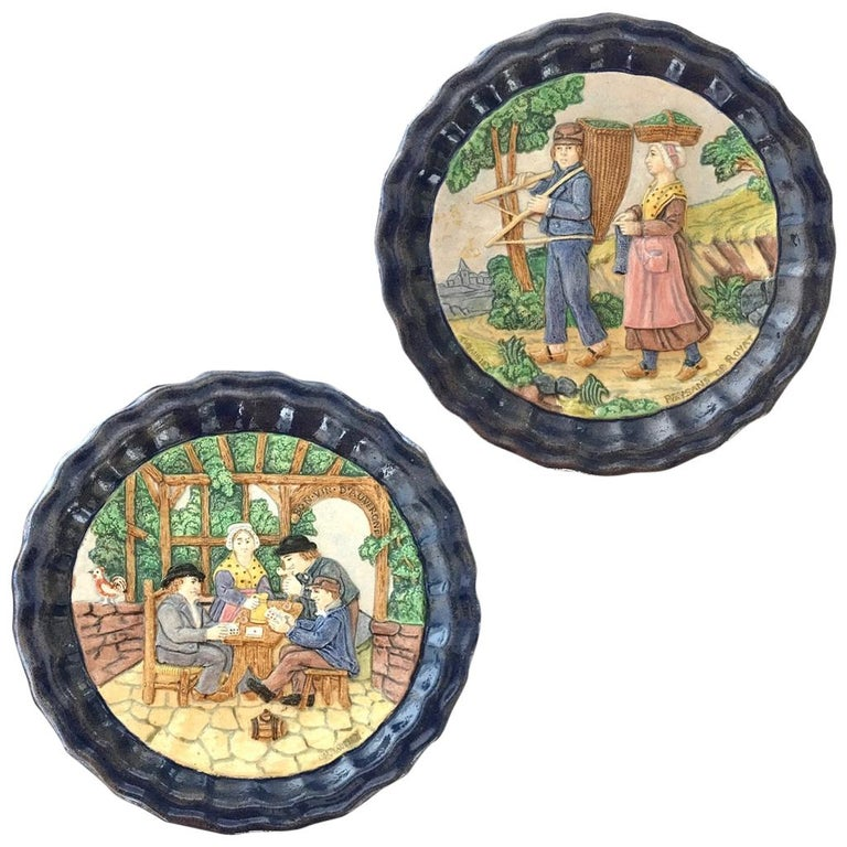 Two quite rare earthenware sculptural decorative plates in barbotine, dated 1880, handcrafted in Clermont Ferrand, central part of France, by Charles Jaubert decorator, engraved signature at the back and front of each dish, substantially framed by a