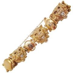 1880 Victorian 14 Karat Yellow Gold Diamond and Red Garnet Lion Bracelet