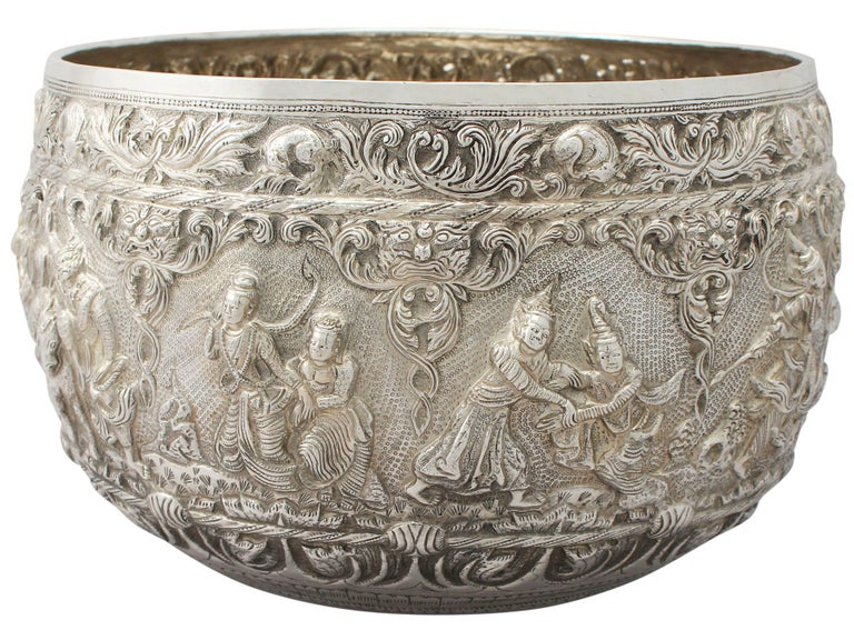 An exceptional fine and impressive, large antique Burmese silver thabeik bowl; an addition to our ornamental silverware collection.  This exceptional antique Burmese thabeik* silver bowl has a circular rounded form.  The surface of the bowl is
