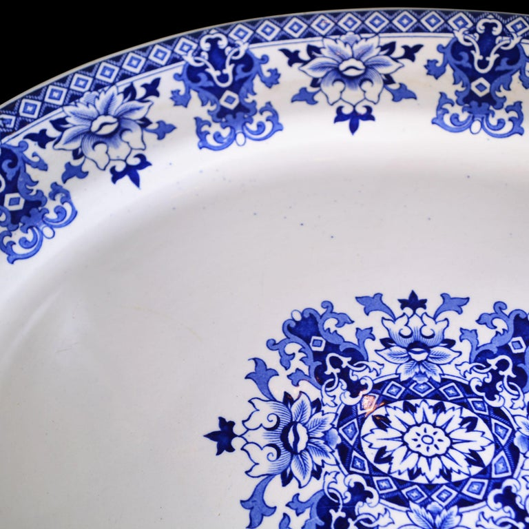 This large platter has the Classic blue and white Lolanthe design. The manufacturer E.F.B & Son is stamped on the back along with the imprint. The platter has an intricate floral center design with coordinating border design. The manufacturer,