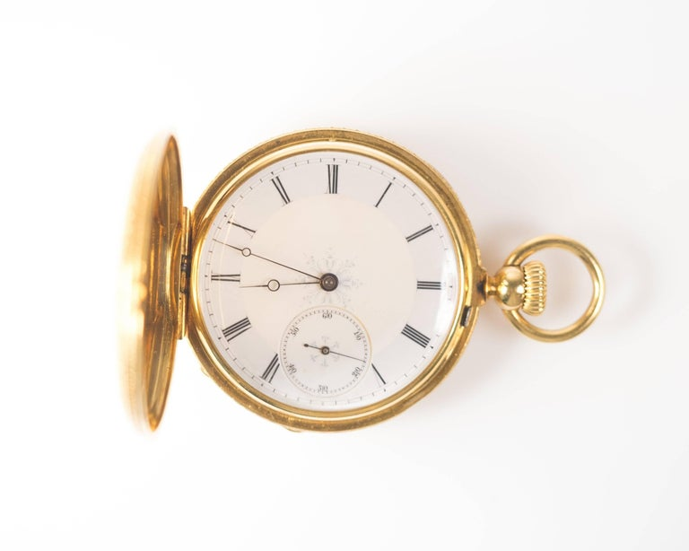 Unique 1880s Pocket Watch Crafted in 18 Karat pocket watch Made by Iconic watch maker Patek Philippe and sold at jeweler A.H. Rodent store front. The hallmarks of the jeweler are visible on the case back.   Pocket watch features a porcelain and