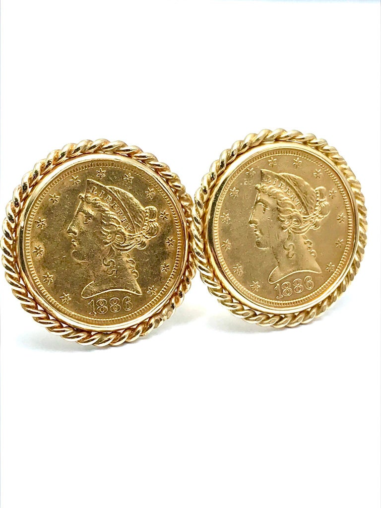 A classic pair of 1886 United States five dollar gold coin cufflinks.  Minted in the US, the coins 0.999 pure gold, set in 14 karat gold frames with a rope edge.  These cufflinks are a timeless set to add to anyone's collection.  The cufflinks